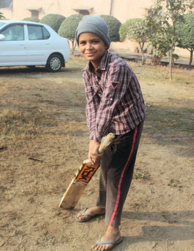 dholpur_boy with cricket mallet